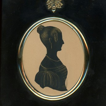 Cut and gilded silhouette of a lady by William Seville