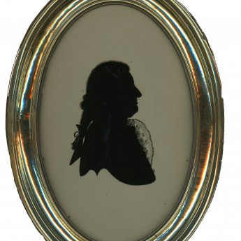 A fine silhouette of a gentleman reverse painted on glass by Walter Jorden