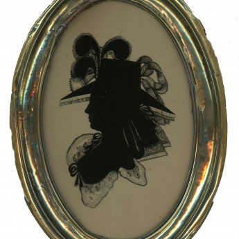 A fine silhouette of a lady reverse painted on glass by Walter Jorden
