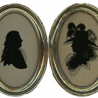A fine pair of silhouettes reverse painted on glass by Walter Jorden