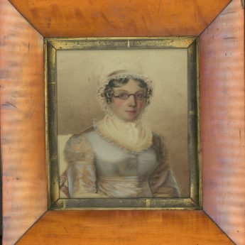 Watercolour portrait of a lady wearing spectacles