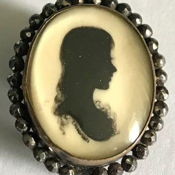 Painted silhouette brooch by Samuel Houghton