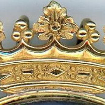 Intricate crest on the frame of a miniature portrait of an aristocratic child