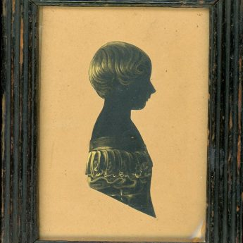 Cut and gilded silhouette of a child with an interesting trade label reverse