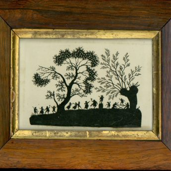 Cut paper picture of folk dancing out in the woods