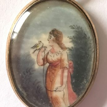 Miniature pendant painting of a lady with a tethered bird