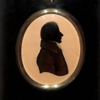 Silhouette reverse painted on convex glass, one of a pair