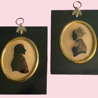 A pair of silhouettes painted on glass
