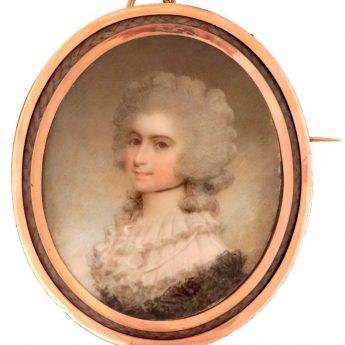 Miniature portrait of a lady painted by Samuel Shelley and set in a gold brooch with a plaited hair surround