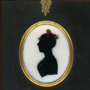 Silhouette reverse painted on glass by Charles Rosenberg and backed with the artist's trade label