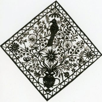 Cut paper picture featuring flowers and a bird.