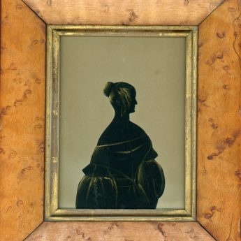 Cut and gilded silhouette of a lady by the Hubard Gallery