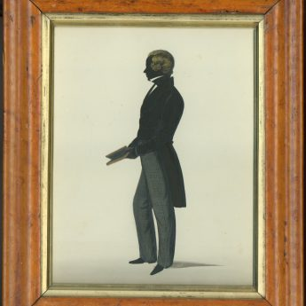 Painted and gilded full-length silhouette of a gentleman in checked trousers