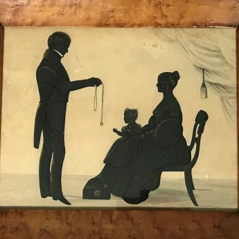 Painted and gilded silhouette conversation piece of a young family