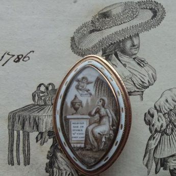 Gold and enamel memorial brooch dated 1786 with a sepia and chopped hair painting