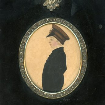 Miniature watercolour of a young boy in a peaked cap