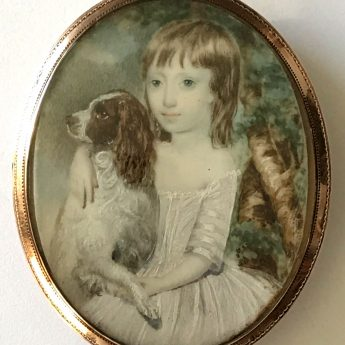 Miniature portrait of a child with his pet spaniel