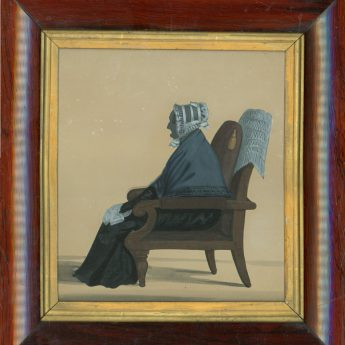 Cut silhouette of an elderly lady seated in an armchair