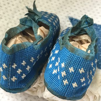A delightful pair of blue shoes for a child