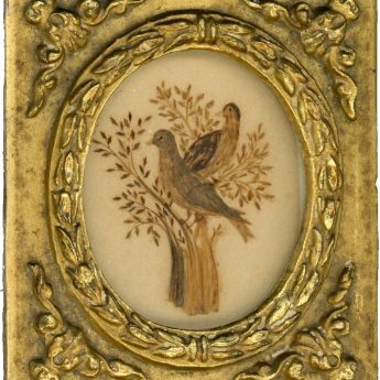 Miniature hairwork picture of birds in a tree