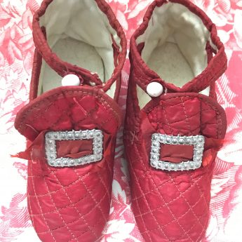A pair of ruby red children's shoes, circa 1800