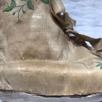 A pair of Georgian child's boots in hand-painted silk