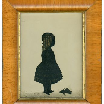 Cut and bronzed silhouette of a child with a doll