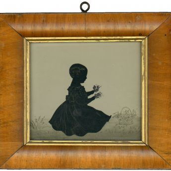 Cut silhouette of a child holding flowers