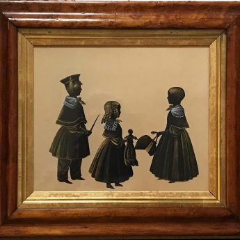 Cut and gilded silhouette conversation piece of three siblings