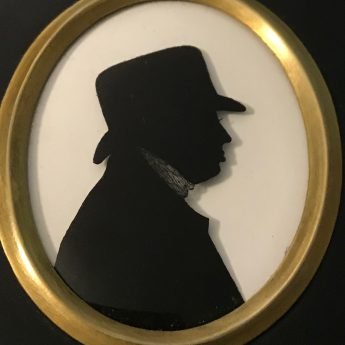 Silhouette of a gentleman in a soft-crowned hat