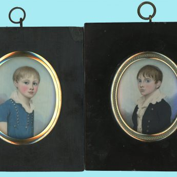 A pair of miniature portraits by Frederick Buck