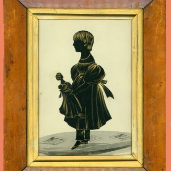 Cut and gilded silhouette of a child with a doll