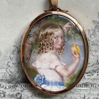 Miniature portrait of a child holding a yellow canary
