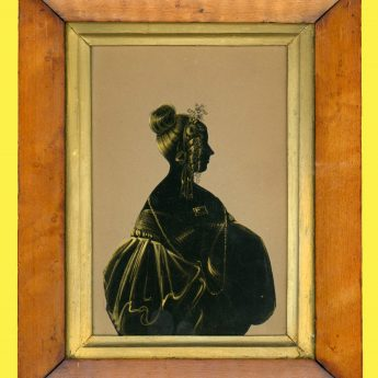 Cut and gilded silhouette of a lady by Hubard Gallery