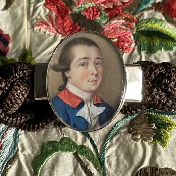 Miniature portrait of a gentleman set in a bracelet with a woven hair band