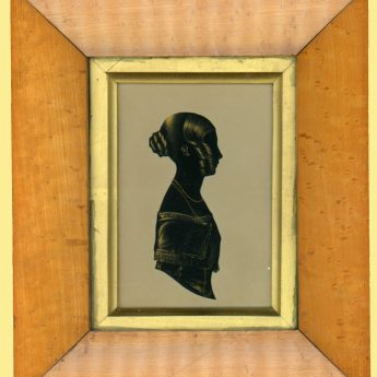 Cut and gilded silhouette of a young lady