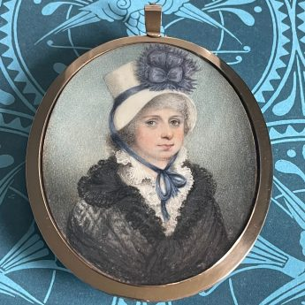 Miniature portrait of a lady in a chip hat trimmed with blue ribbon