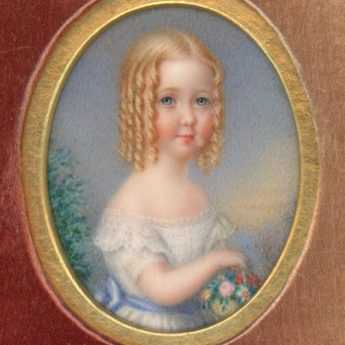 Miniature portrait of a child in a carved case